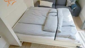 The duvet is strapped up with a strap when the bed is ready to be folded up