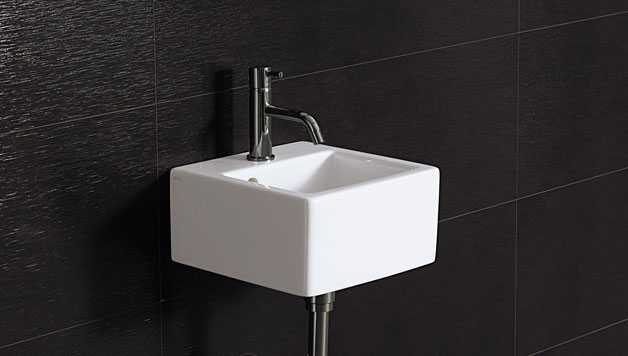wall-mounted sink in tiny home toilet