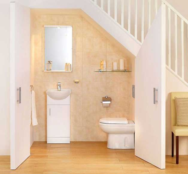 4 cool under staircase toilets and bathrooms for Bathroom designs under stairs