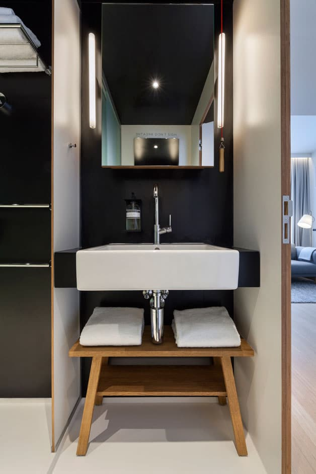 apartments inside bathroom. toilet bath Zoku  Tiny Studio Apartment Building Amsterdam