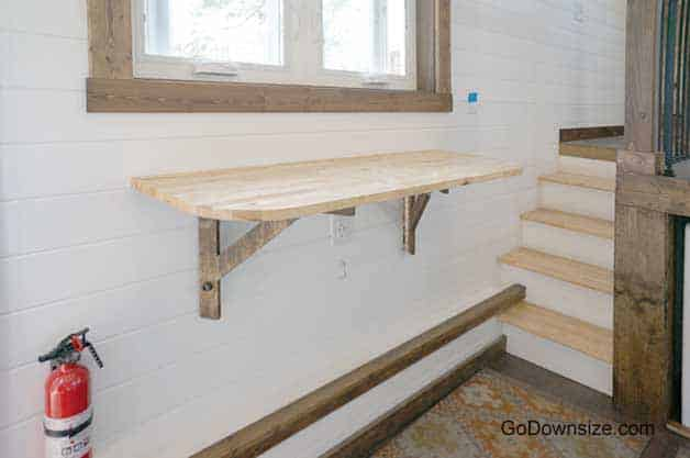 Small wall-mounted table in a tiny house (up-position)