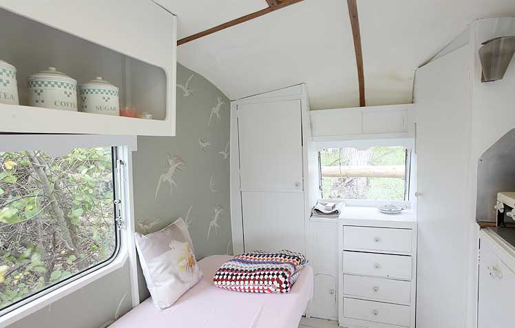 Everything Is Made To Utilize The Vertical Space And Wallpaper Goes Well With White Finish On Cabins Ceiling