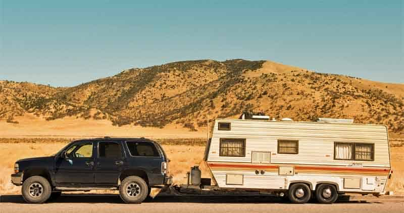RV in sunshine with solar power on roof