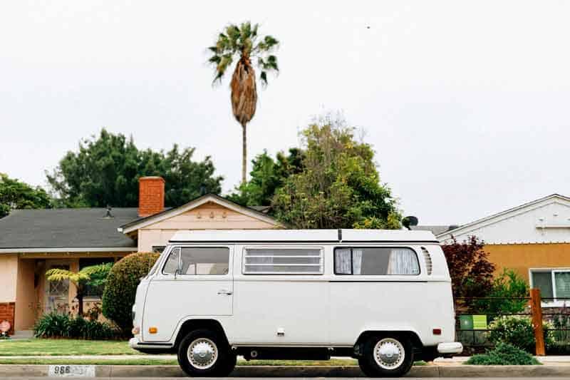 VW vintage camper parked on street