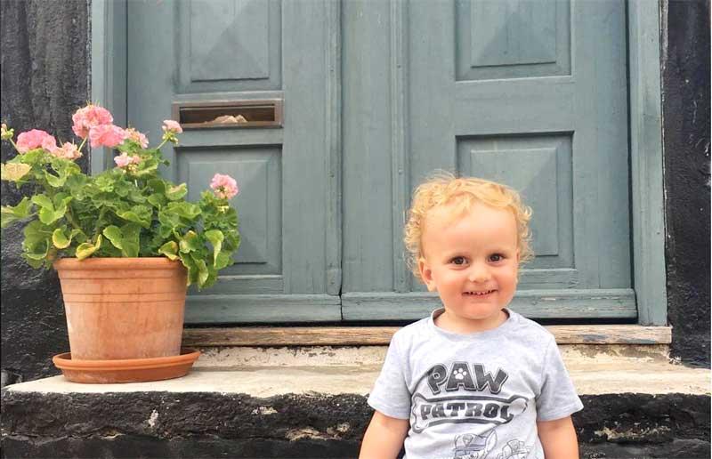 Max in front of a door